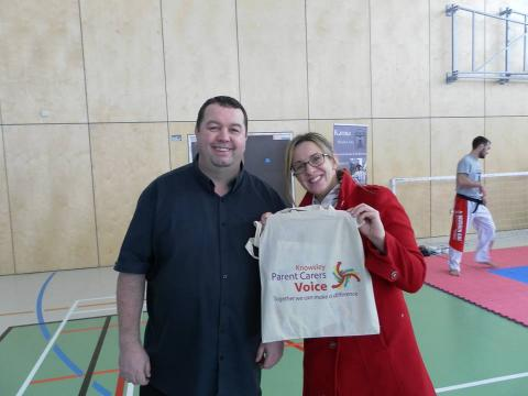 Parents with KPCV bag at event